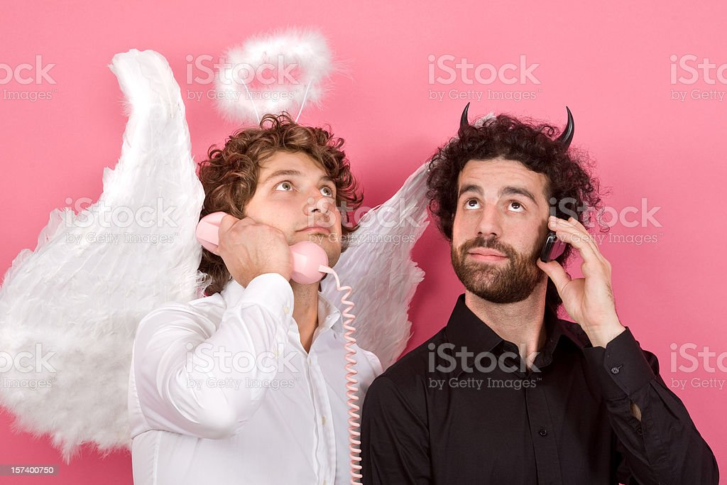 white angel communicate with black devil royalty-free stock photo