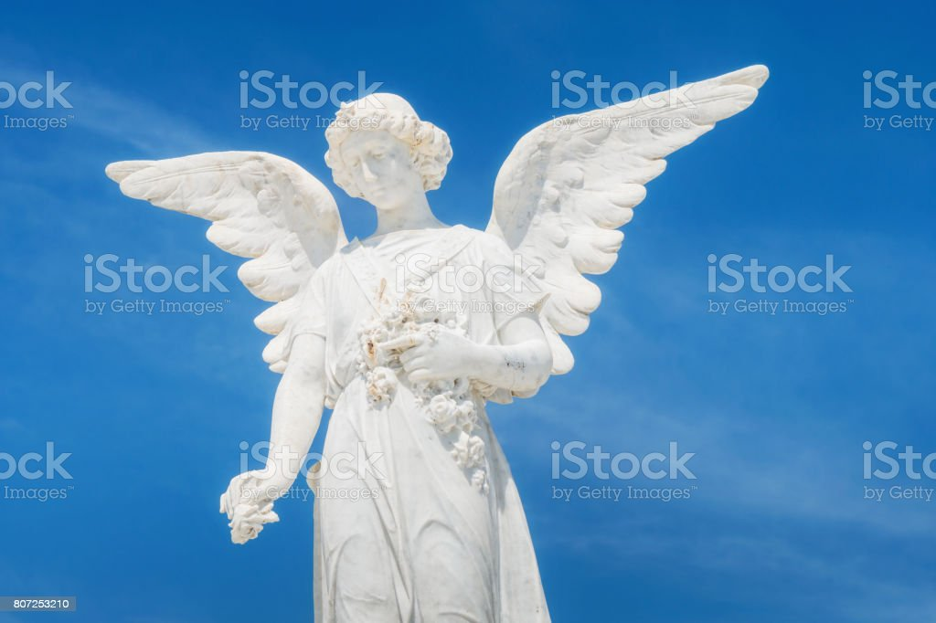 White angle marble statue at the cemetery stock photo