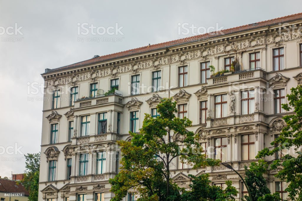 white apartment building with ornaments stock photo