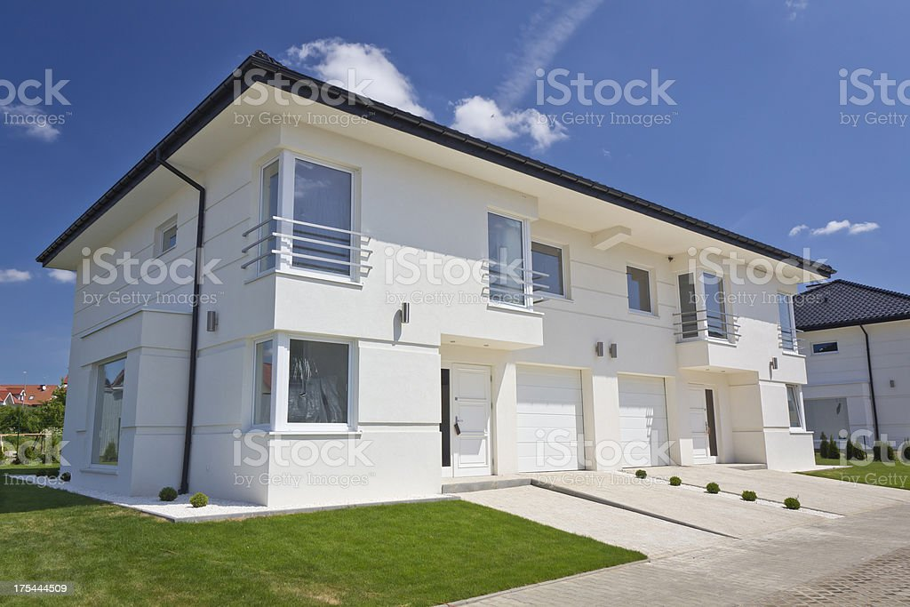 White apartment house against blue skies royalty-free stock photo