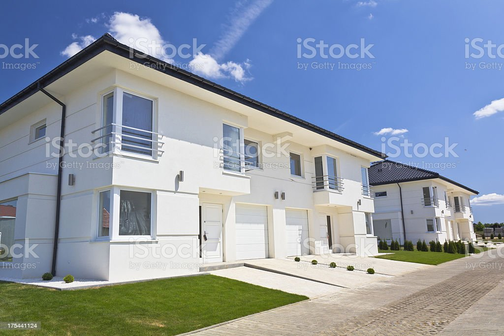 White apartment houses against blue sky royalty-free stock photo