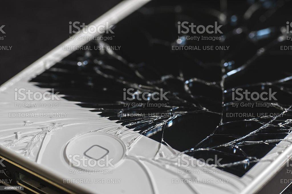 white Apple iPhone 4s with broken Retina display royalty-free stock photo