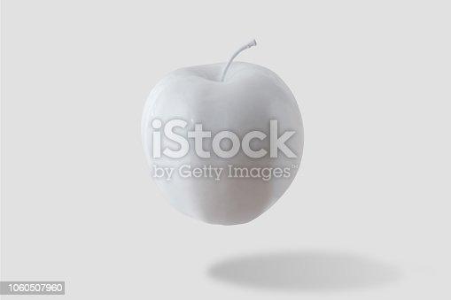 istock White apple on white background. Minimal style. Food concept. 1060507960
