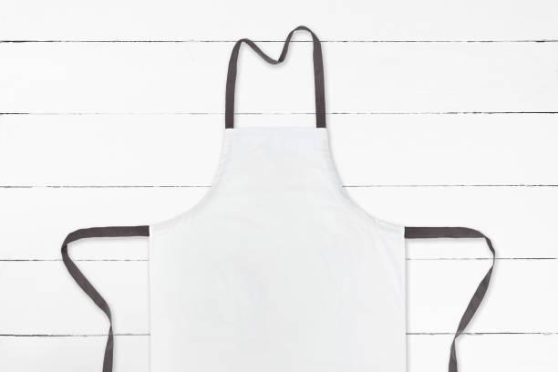 Delantal blanco en textura madera blanco - foto de stock