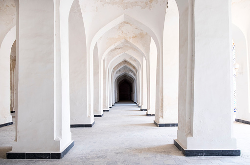 White Arabian arches in Kalyan Mosque that was built 16th-century. Bukhara, Uzbekistan. Central Asia.