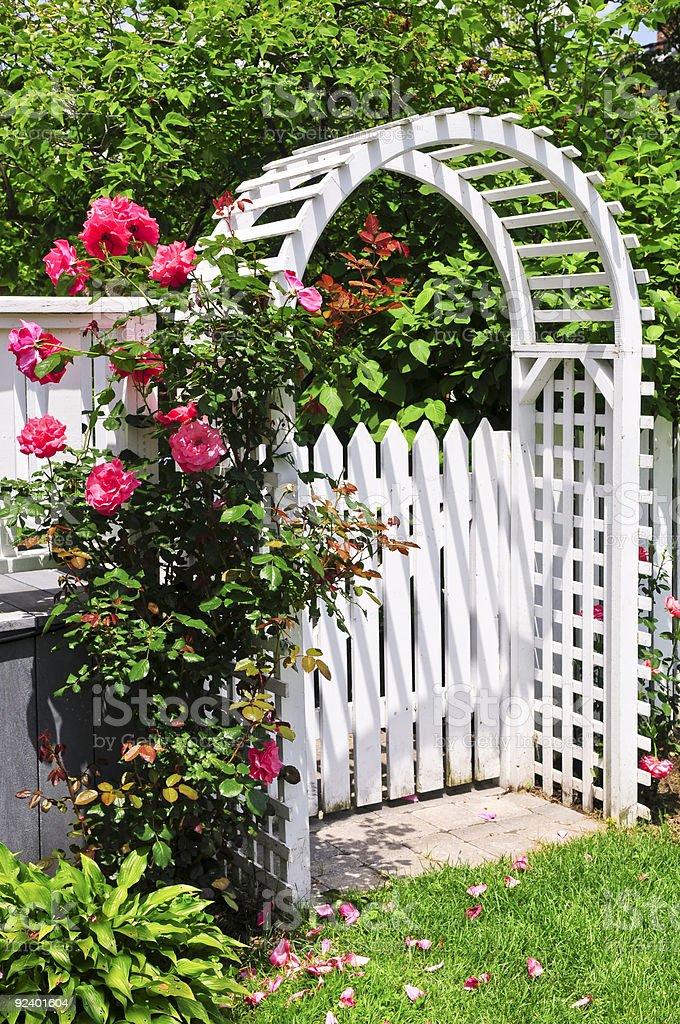 White arbor in a garden stock photo