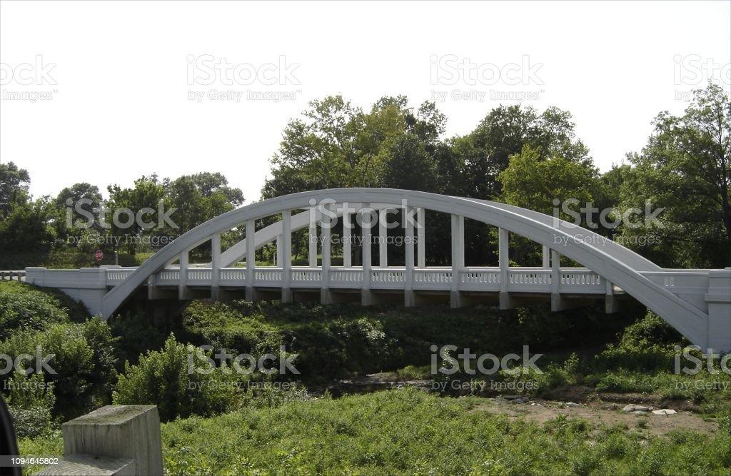 White arched bridge stock photo
