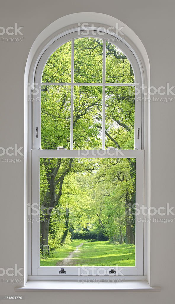 white arched window and parkland view stock photo