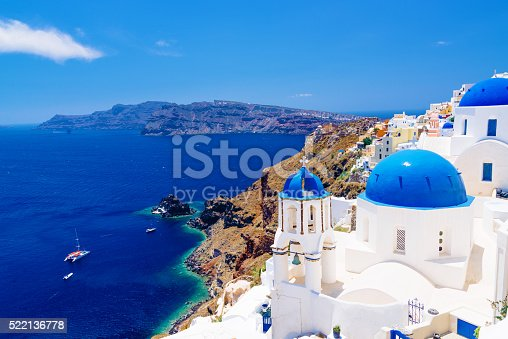 istock White architecture and famous little churches with blue domes 522136778