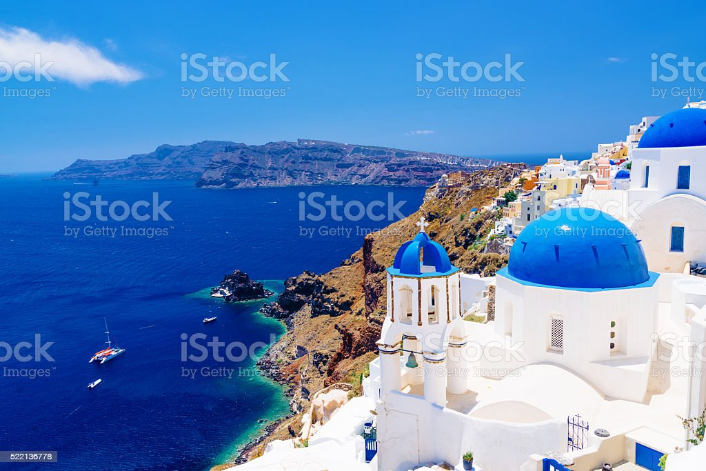 White architecture and famous little churches with blue domes stock photo