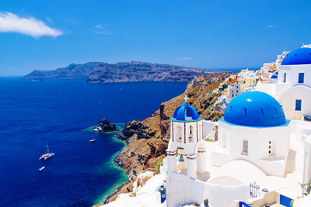 white architecture and famous little churches with blue domes - caldera bildbanksfoton och bilder
