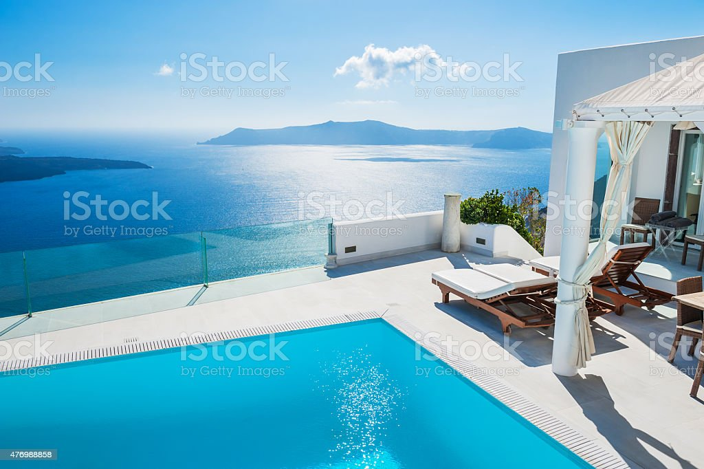 White architecture on Santorini island, Greece. Swimming pool in...