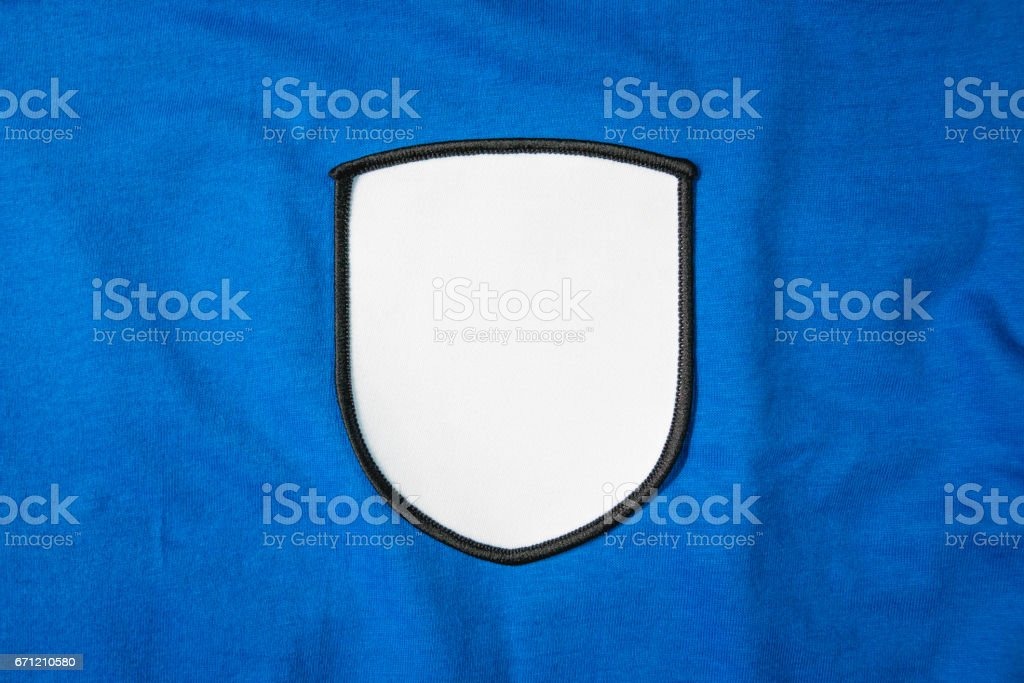 White arm patch on blue sport shirt. stock photo