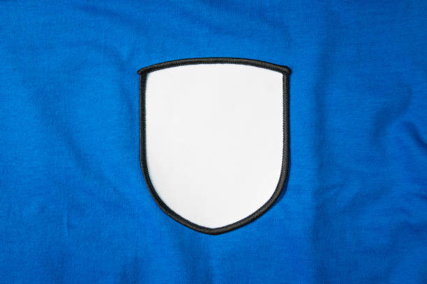 white arm patch on blue sport shirt. - badge logo stock pictures, royalty-free photos & images