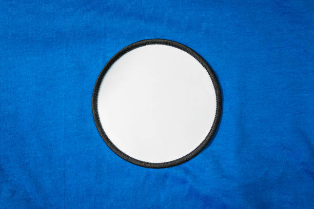 white arm patch on blue sport shirt. - badge logo stock photos and pictures