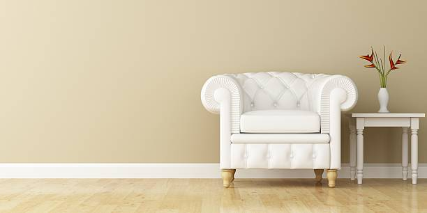 White armchair and wall decorated of interior design stock photo