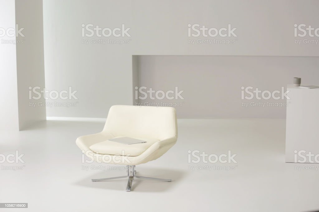 white armchair in white room gm