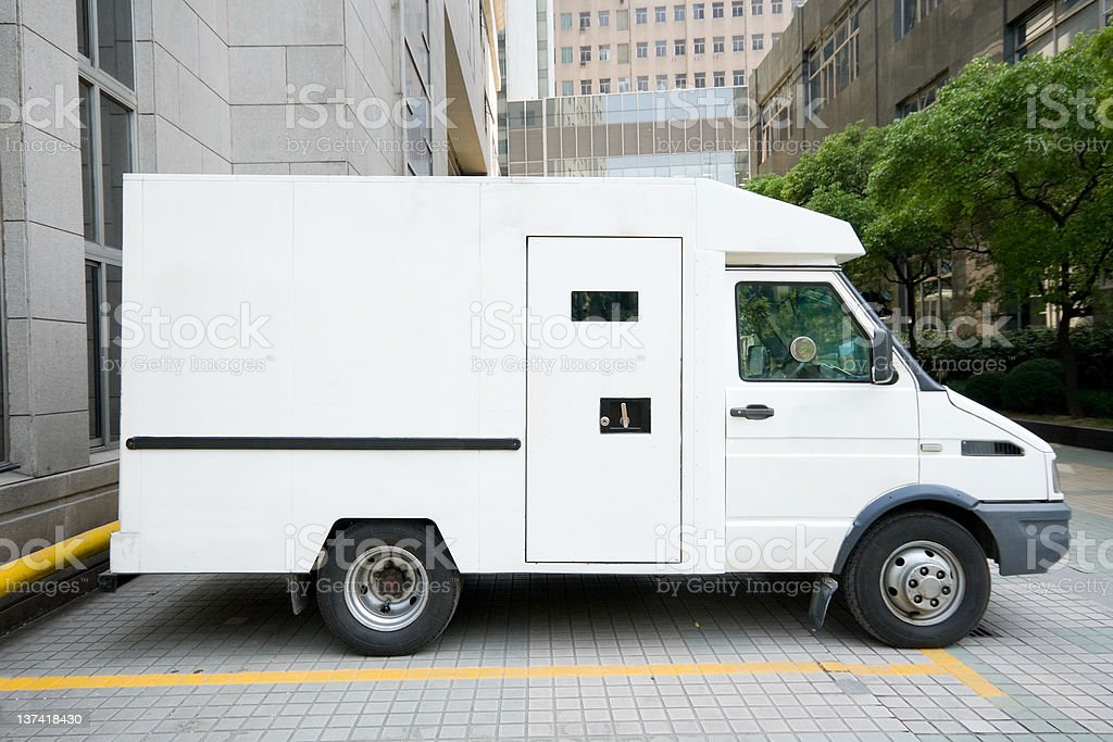 White Armored Car Van Parked in Driveway, Downtown Shanghai, China stock photo