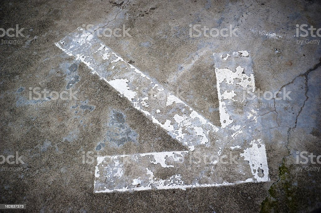 White arrow on pavement royalty-free stock photo
