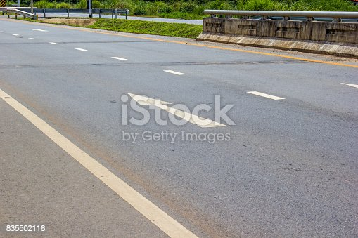 istock White arrow pointing forward on the road in Thailand. Arrow on asphalt road 835502116
