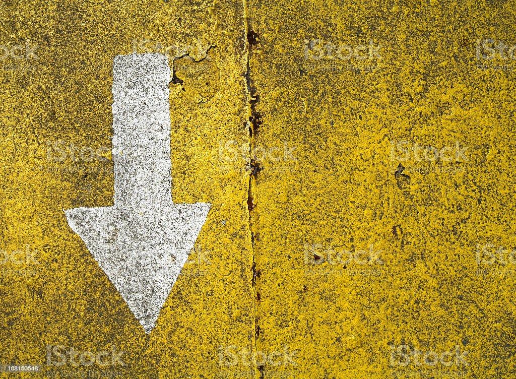 White Arrow Sign on Road royalty-free stock photo