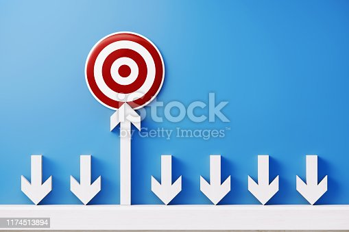 1014851396 istock photo White Arrows and a Bulls Eye Target Forming a Bar Graph on Blue background 1174513894