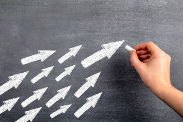 White arrows indicate the direction of tracking. Follow, leader, social media and development concept stock photo