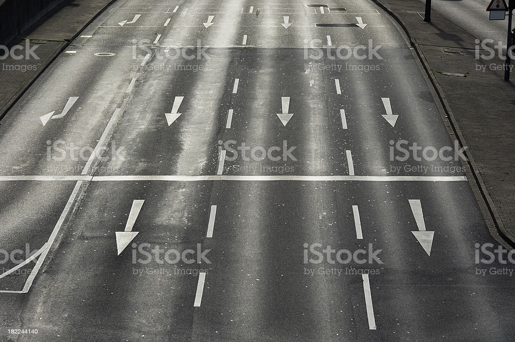 White arrows on an avenue royalty-free stock photo