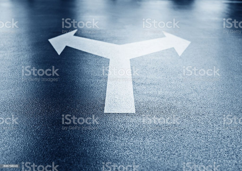 White arrows on an empty asphalt parking parking lot stock photo