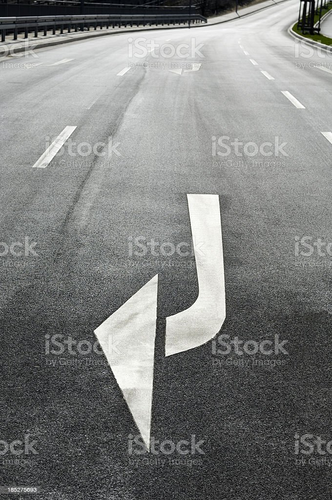 White arrows on an empty city street royalty-free stock photo
