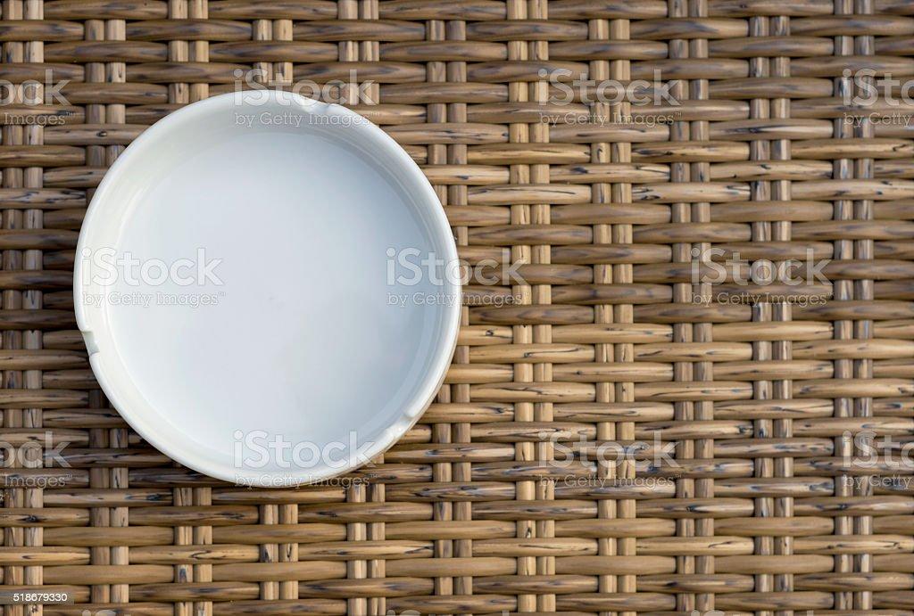 White ashtray on wood background stock photo