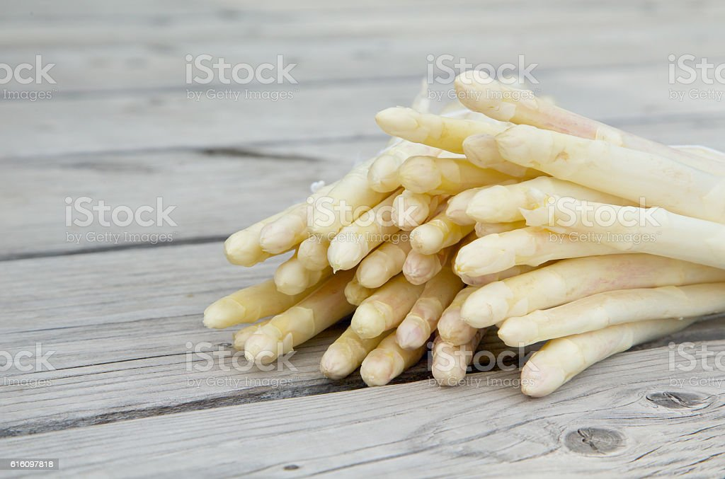 White asparagus on a wooden surface - Photo