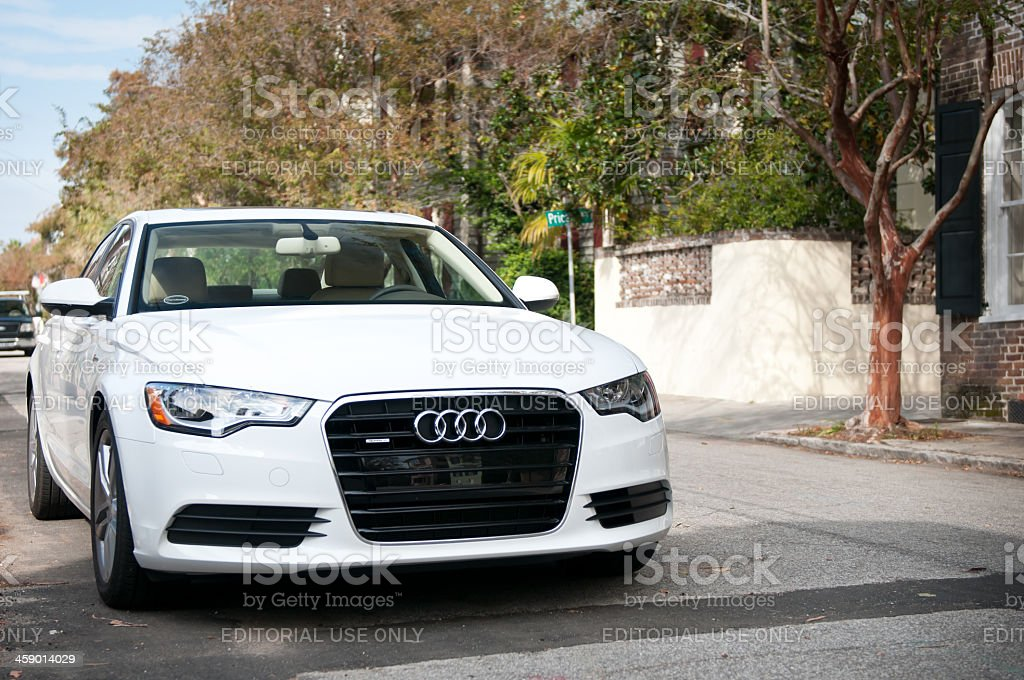 White Audi A6 (C 7 series) in Charleston, USA Charleston, USA - October 31, 2011: White Audi A6 (C 7 series) parked in an alley in Charleston, South Carolina, USA. Focus on the front grill. The Audi A6 is a premium segment car with up to 415 horsepowers and a V6 engine. This series was built between 2011 to present. Audi Stock Photo