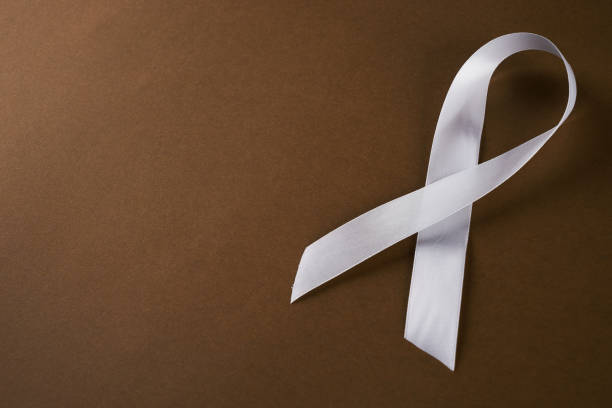 white awareness ribbon - award ribbon stock photos and pictures