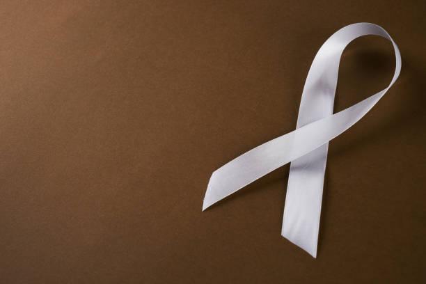 White awareness ribbon stock photo