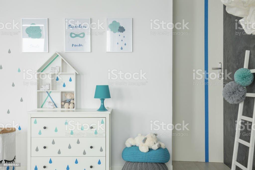White baby bedroom with dresser stock photo