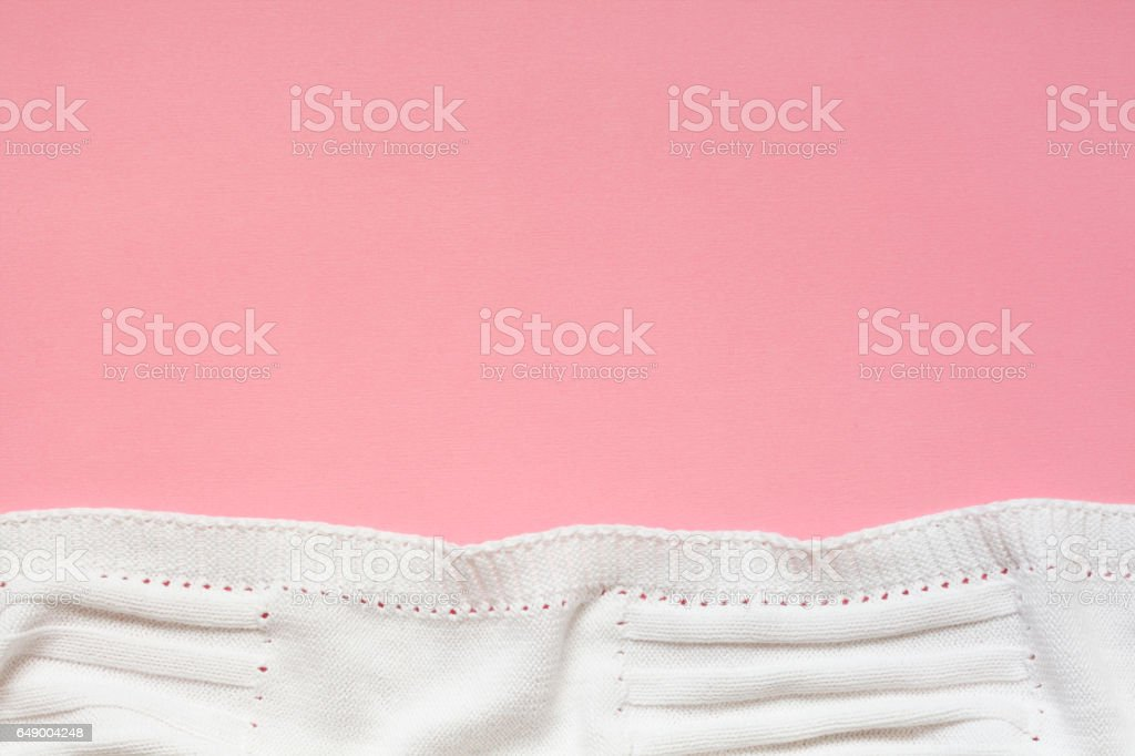 White Baby Blanket On Pink Background stock photo