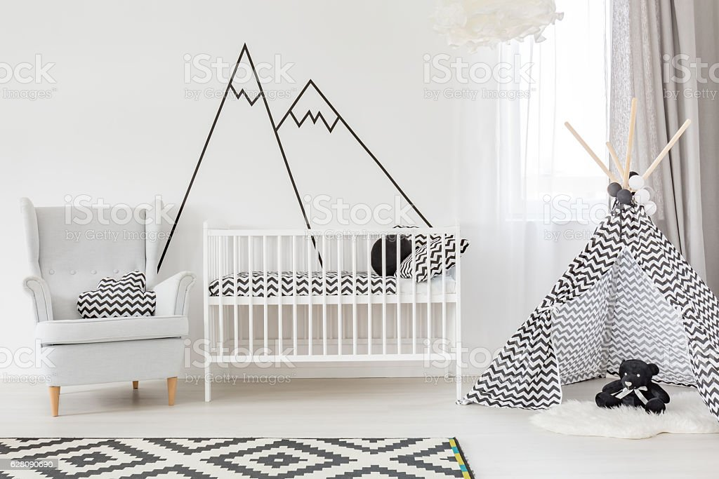 White baby room with cot stock photo