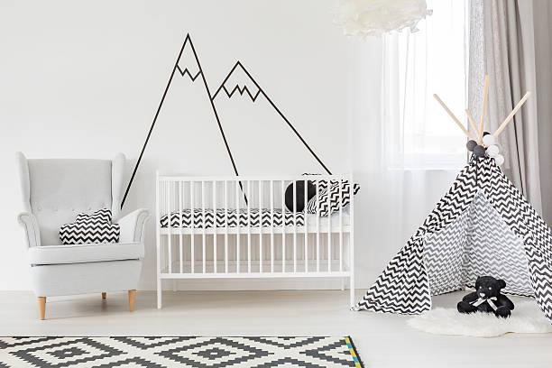 white baby room with cot - kinderzimmer wand stock-fotos und bilder