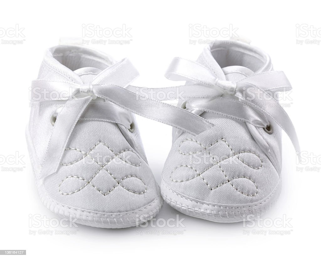 White baby shoes against white background stock photo