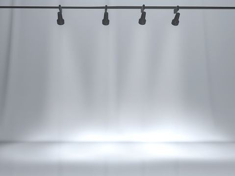 White backdrop in room with spotlight on top