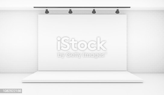 1089180420istockphoto White Backdrop Stage in Room with Brick Wall 1082522156