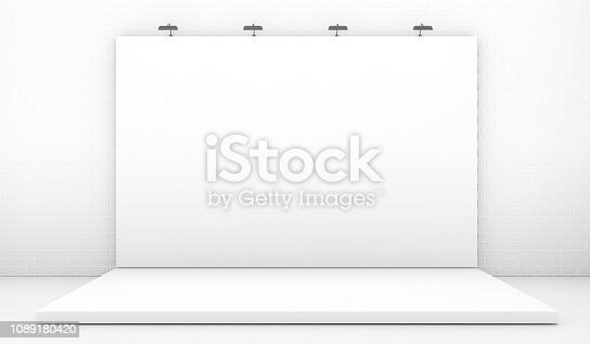 1089180420istockphoto White Backdrop Stage in Room with Brick Wall 1089180420