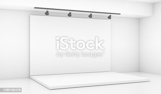 1089180420istockphoto White Backdrop Stage in Room with Brick Wall 1089180426