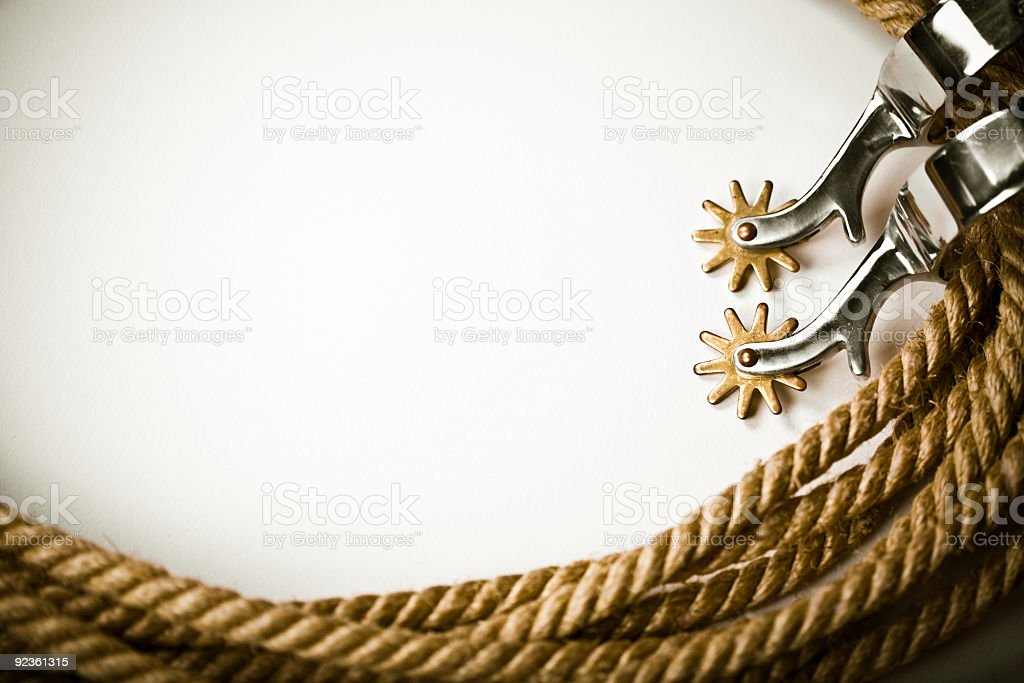 A white background bordered in ropes and spurs stock photo