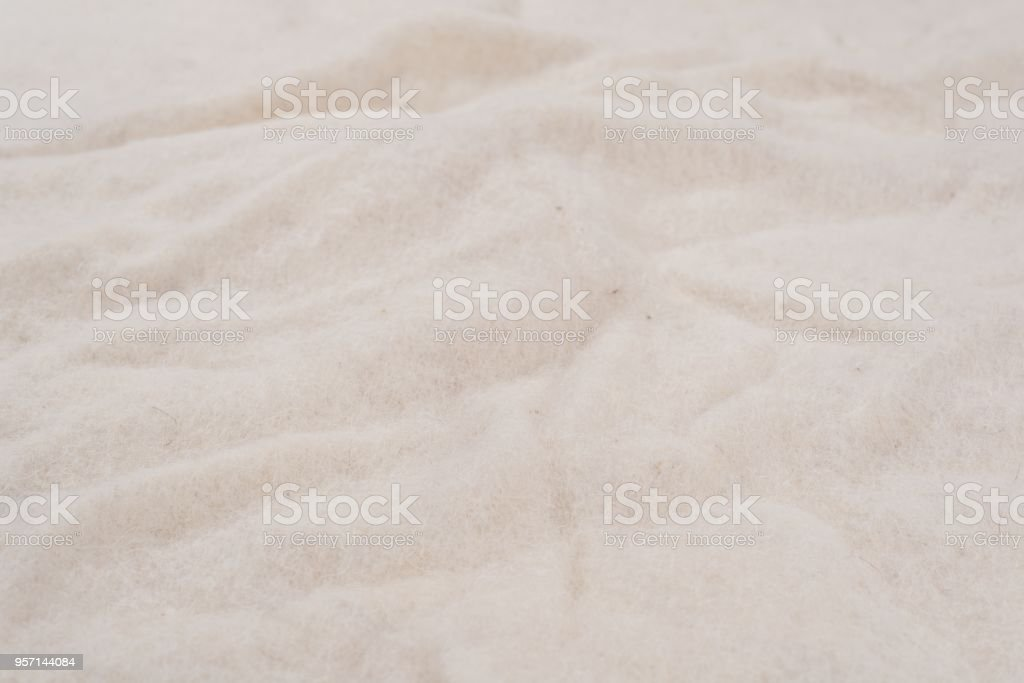 White background of non-woven natural woolen material stock photo