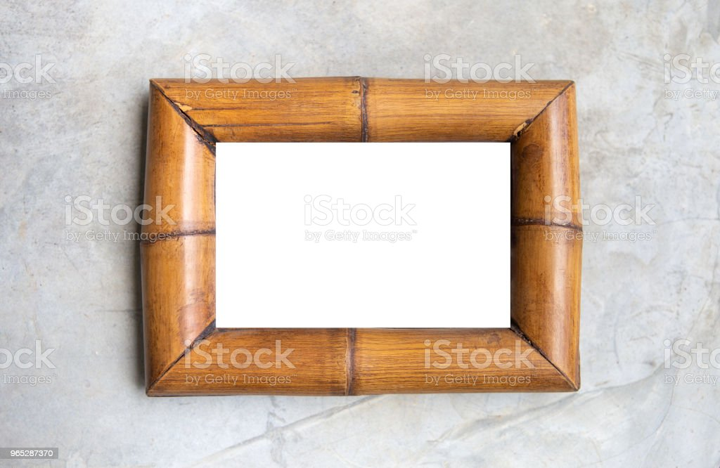 White background on bamboo wood picture frame royalty-free stock photo