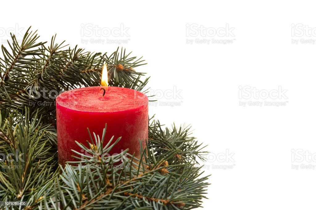 Burning Christmas Tree.White Background With And Christmas Tree Branches And Burning Candle Stock Photo Download Image Now