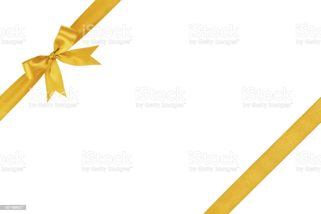 White background with golden ribbon and strand on 2 corners stock photo
