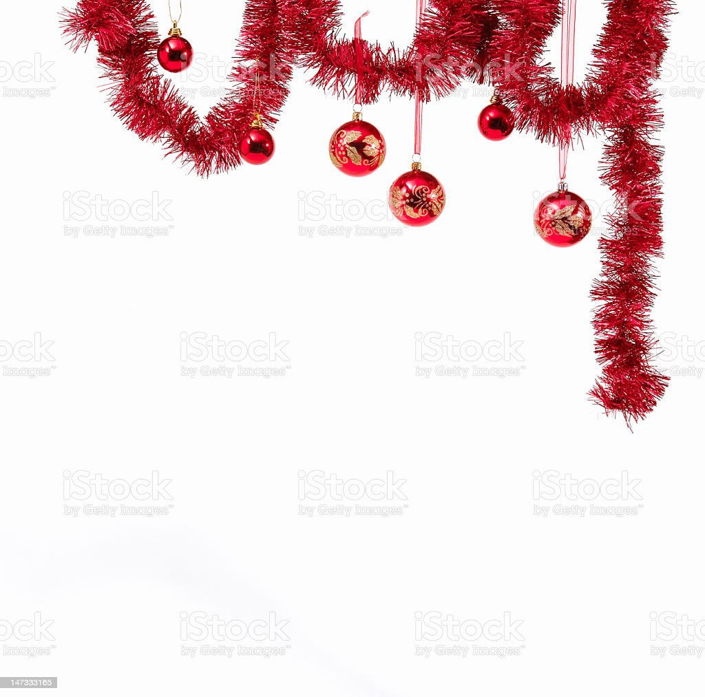 A white background with red hanging Christmas decorations stock photo